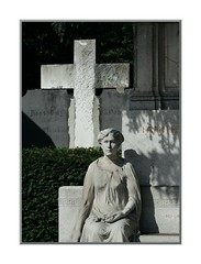 For a moment I thought she was alive... (Walter A. Aue) Tags: vienna wien sculpture cemetery sterreich cross alive hernals 17thdistrict austria walteraaue hernalserfriedhof