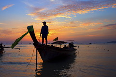 railay beach (Roberto.Trombetta) Tags: ocean sunset red sea vacation sky panorama orange cloud sun holiday fish man leave beach beautiful silhouette night sunrise canon dark landscape dead thailand leaving boat amazing fishing fisherman sand waiting asia long alone loneliness quiet cloudy awesome tail calm stunning wait lone lonely krabi 6d railay canon6d