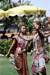 19-527 (ndpa / s. lundeen, archivist) Tags: show costumes people color film 35mm thailand dance clothing hands women dancers dancing display bangkok traditional nick performance hats tourists thai 1970s umbrellas performers thaidancing 1972 19 1973 headdress dewolf classicaldance youngwomen traditionaldance thaidancers traditionalclothing headdresses traditionaldancing thaidance traditionaldancers nickdewolf photographbynickdewolf classicaldancers classicaldancing reel19