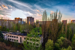 Sunset in Pripyat city (jeepeg!) Tags:    abandoned sunset exclusion  sky kindergarten spring city zone  pripyat  clouds       ukraine ua     forgotten old green thicket lost