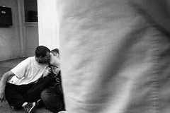 R0011294 (G. L. Brown) Tags: broadway couple kissing sidewalk sitting nashville nashvillestreetphotography