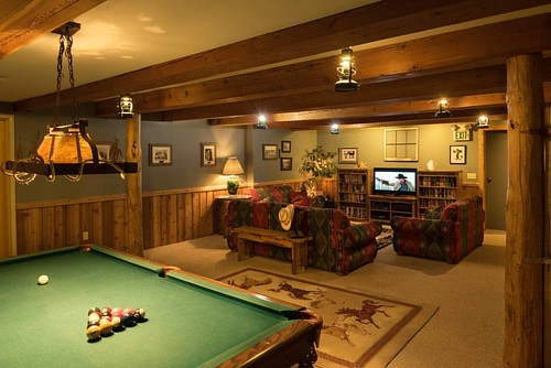 The Rec Room in the log lodge at Western Pleasure Guest Ranch is perfect place to play,  relax and connect. Bonus points if you can tell me what classic western movie is on the TV screen in this picture!