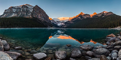 Inviting- October 8, 2016 (zachary.locks) Tags: ab alberta alpenglow angle banff big blue boulders canada capped clear cold cy365 early fall foreground golden green hour invite inviting lake louise morning mountains national orange panorama park reflection rocks sky snow sunrise wide zlocks