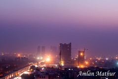 Fading into one (Amlan Mathur) Tags: apartment asia building construction development dusk evening homes houses india infrastrcture metro millenniumcity night noida property purple realestate silhouette sky skyscraper