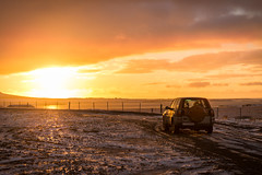 SUV car during sunset in Iceland (Istockr) Tags: blizzard cold conditions country driving empty free godafos godafoss green highway hills holiday horizon iceland icelandic landscape lane lifestyle lights looking lost mountain mountains natural nature night nobody northern nowhere path road sky snow snowfall snowing snowstorm space stars storm success tiremarks tiretracks tracks travel vacation weather white winter