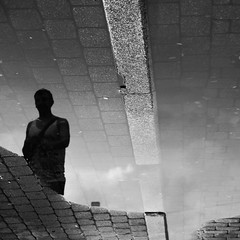 Grey days passing by (mkorolkov) Tags: street streetphotography puddle puddlegram reflection pavement silhouette figure bricks brickroad blackandwhite monochrome fujifilm xe1 xc50230