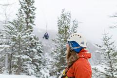 Winter Ziplining (Newfoundland and Labrador Tourism) Tags: western winter snow ziplining zip lining fun man guy girl people air sky yellow red coat helmet trees marble mountain tours