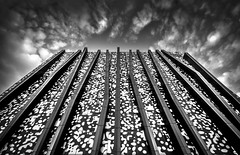 University of Melbourne Commerce Building (phunnyfotos) Tags: phunnyfotos australia victoria vic melbourne architecture building universityofmelbourne melbourneuniversity lookingup mono bw monotone metier3 thespotbuilding spotbuilding carlton parkville university economicscommercebuilding nikon d5100 nikond5100 sigma1020mm sky skies clouds facade pattern campusarchitecture