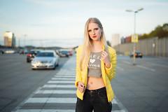 parking deck VI (Michael Kremsler) Tags: shooting model girl portrait fashion streetfashion parkingdeck carpark crosswalk jeans jacket bellytop evening blond availablelight bokeh outdoor car city