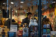 Countdown to Christmas (Silver Machine) Tags: bath somerset man shopping giftshop teddybears dog christmas games cards snowflakes windowdisplay window streetphotography street streetportrait candid fujifilm fujifilmxt10 fujinonxf35mmf2rwr