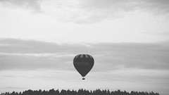 Balloon (Matutino.) Tags: sky white black hot clouds finland fly afternoon air magic balloon pines land float vesilahti
