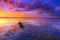 lonely boat (imrankadir) Tags: sunset sky seascape reflection colors clouds boat filter kudat tipofborneo simpangmengayau rgnd