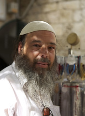 (Caitlin H. Faw) Tags: light shadow portrait man color smile face june canon hair beard nose eos israel necklace eyes jerusalem 5d vendor merchant oldcity kippah yerushalayim kippa markiii 2013 caitlinfaw caitlinfawphotography