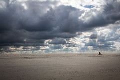 Endless Freedom (bernd obervossbeck) Tags: light sky beach strand germany person licht sand himmel dramaticsky langeoog weite minimalistic vastness width eastfrisianislands minimalistisch dramatischerhimmel minimalisticlandscape ostfriesischeinsel minimalistischelandschaft