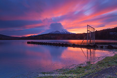 Mt. Fuji at Sunset. (baddoguy) Tags: longexposure sunset mountain lake reflection beach japan horizontal volcano pier peaceful tranquility nopeople landmark images snowcapped shore getty fujisan iconic afterrain mtfuji yamanashi yamanakako coneshaped traveldestination movingcloud