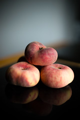 _MG_4914 (Jagot) Tags: food table granite peaches canonef50mmf14 canoneos6d vision:sunset=0819 vision:sky=0752