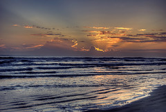 Moments before Sunrise (photographybyjameshoffman) Tags: ocean morning blue sea sky orange sun reflection beach clouds sunrise sand surf purple florida sandy horizon shoreline shore daytona sunrays daybreak vision:beach=0675 vision:sunset=0958 vision:clouds=099 vision:outdoor=0941 vision:sky=099 vision:car=0648