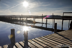 Pier (DMeadows) Tags: park wood winter sun lake reflection water rural landscape island scotland countryside wooden dock post jetty country deck national flare loch posts lomond decking trossachs sunflare inchcailloch davidmeadows dmeadows davidameadows dameadows