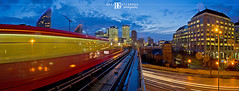 London Docklands Panorama (davidgutierrez.co.uk) Tags: city uk travel blue light red sky urban panorama london art tourism colors skyline architecture train twilight cityscape dusk transport railway londres docklands lighttrails dlr  londyn    pentaxk5