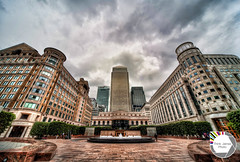 The fountain Outside Canary Wharf (Think James Photo) Tags: windows london water fountain glass architecture skyscraper shopping bench square office seat centre entrance symmetry business highrise cylinder symmetrical canarywharf hdr highdynamicrange hdri