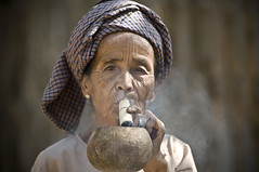 old woman smoking local cigar in Bagan, Myanmar (marc scholler) Tags: voyage architecture montagne temple soleil site construction asia antique buddha or burma stupa smoke religion culture style cigar bouddha histoire destination oldwoman myanmar asie typical chteau smokin chaud magnifique cigare monastre calme frisson tourisme bagan adoration ancien patrimoine asiatique bouddhisme pagode lumineux spirituel religieux typique birmanie cieux inspirer traditionnel bouddhiste impressionnant pagodes repre majestueux excitant sanctuaires tonnant birmanes tonner bestportraitsaoi elitegalleryaoi