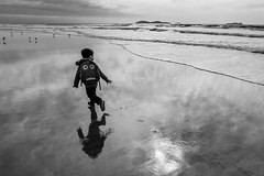 not a care (Conor F. Shine) Tags: beach running carefree child iceboxcool reflection