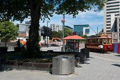 Trams are Running Again (Jocey K) Tags: trees newzealand christchurch people building architecture shadows cranes trucks cbd diggers trams bins cathedralsquare earthquakedamage