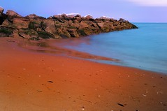Red Planet. (DigitalCanvas72) Tags: longexposure snow beach rocks earth alien redsand bluewater planet softwater alienplanet nikond90 nikon1685mmvr polarizerfiler