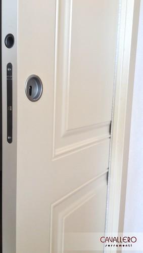 Dettaglio porta pantografata scorrevole a due pannelli 111CP