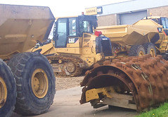 Compact Yard (Bournemouth 71B / 70F) Tags: plant building yellow digging paving grading making rolling loading loaded lifting construct earthmoving trenching shifting excavating constructing leveling