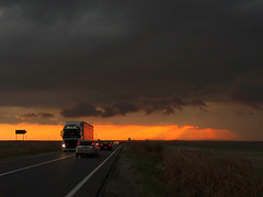 almost surreal (but real) (Luana 0201) Tags: sunset storm clouds car road rays