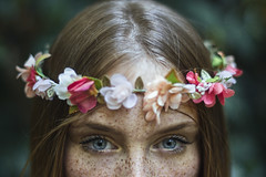 Whispers of a secret (Enrico Cavallarin) Tags: flowers flowerscrown freckles eyes face blueeyes portraiture portait ritratto blonde fairy fairyland magic emotional 50mm