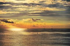 Cuando el sol me toma del pelo (explored 2016/10/11) (Fnikos) Tags: sea seascape serene sun sky skyline light water boat cloud vehicle outdoor