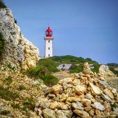 Rocks and Alfanzina Lighthouse (Cycling Man) Tags: landscape rocks light lighthouse coast algarve alfanzina