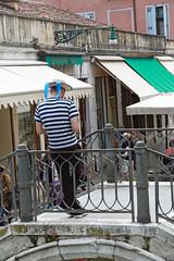 Venice gondolier (Kurtsview) Tags: italy venice shops shopping people gondolier outdoor bridge