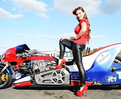 Holly_9888 (Fast an' Bulbous) Tags: top fuel bike motorcycle eurol sharkattack biker chick babe girl woman pinup model long brunette hair tight leather pvc leggings jeans red shoes high heels stilettos drag race strip track pits santa pod england eurofinals people outdoor pose nitro