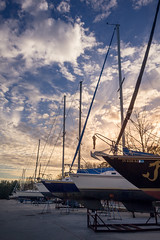 Sail Away into the Sky (benjamintrueblood) Tags: sky boat sailboat sail sunset golden hour blue clouds cloud leading lines lighting landscape nature beauty lake ocean water land