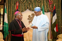 PRESIDENT BUHARI RECEIVES OUTGOING HOLY SEE AMB. 3. President Muhammadu Buhari receives a parting gift from the out going Ambassador of Holy SEE, H.E Archbishop Nasujja Apostolic Nuncio at the State House in Abuja. PHOTO; SUNDAY AGHAEZE. NOV 10 2016.