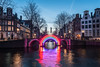 Bridge of the Rainbow (McQuaide Photography) Tags: amsterdam noordholland northholland netherlands nederland holland dutch europe sony a7rii ilce7rm2 alpha mirrorless 1635mm sonyzeiss zeiss variotessar fullframe mcquaidephotography lightroom adobe photoshop tripod manfrotto light licht bluehour dusk twilight water reflection stad city urban waterside lowlight architecture outdoor outside waterfront capitalcity capital illuminated building longexposure herengracht canal gracht amsterdamlightfestival lightfestival bridgeoftherainbow gilbertmoity installation art artwork canalhouse grachtenpand bridge brug arch arches old rainbow colours colors colour wideangle groothoek