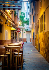 A Cozy Little Alley (k009034) Tags: street city travel beautiful sign canon table landscape photography eos 350d restaurant spain chair alley scenery tavern lantern fuengirola beautifulearth