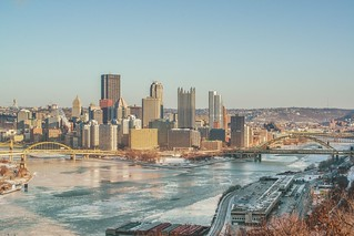 Pittsburgh skyline and the ice at the Point from the West End Overlook in winter