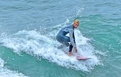 Surfer - Huntington Beach Pier (thinduck42) Tags: ocean california motion sports surf pacific action surfer wave surfing panasonic surfboard southerncalifornia huntingtonbeach watersport fz200