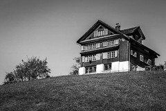 overlooking (alexhaeusler) Tags: switzerland blackwhite overlooking building farm