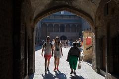 Reflecting on Brugge (paul indigo) Tags: belgium bruges brugge halletoren paulindigo arch architecture couple streetphotography sunglasses sunlight tourism travel walking