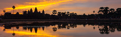 Panorama of Angkor Wat at Dawn. (baddoguy) Tags: angkor architecture asia attractions awakening beautiful buddhism building cambodia clouds complex concept copyspace dawn destination dramatic famous heritage hinduism historic hope illuminated landmark landscape nature outdoor palace palm panorama peaceful place places reap reflection religion rural serenity siem silhouette sites sky stone sunlight sunrise sunset temple tourism tourist tranquility travel tree unesco wat water world worship