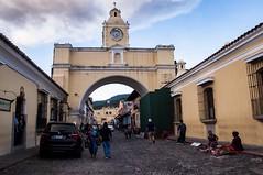 Santa Catalina Arch (Laura Paige) Tags: laurapaigephotography lauraaustin antigua guatemala travel streetphotography nikon yellow clock time santacatalina volunteer cobblestone cloud lauratheexplora