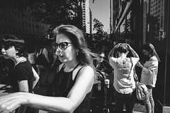 Busy corner full of women in NYC (L A Nolan) Tags: 185mmf28 28mmequiv day fujifilmx70 glasses manhattan newyork newyorkcity newyorknewyork ny nyc outdoors outside people streetphotography thebigapple women