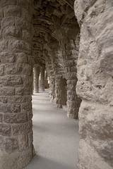 Round the Twist (Jon and Sian Bishop) Tags: october 2016 autumn spain europe barcelona park guell parkguell outdoor vertical light stone arch column support lead path circular detail texture corner round