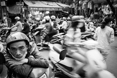 Portrait w/ scooters @ Hanoi (PaulHoo) Tags: hanoi vietnam city urban citylife bw monochrome blackandwhite contrast people men fujifilm x70 2016 asia portrait streetportrait streetcandid candid traffic scooter crowdy speed helmet