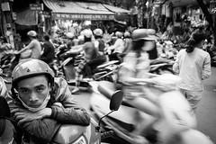 Portrait w/ scooters @ Hanoi (PaulHoo) Tags: hanoi vietnam city urban citylife bw monochrome blackandwhite contrast people men fujifilm x70 2016 asia portrait streetportrait streetcandid candid traffic scooter crowdy speed helmet